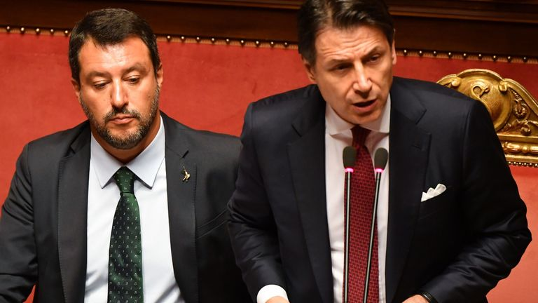 Italian Prime Minister Giuseppe Conte (R), flanked by Deputy Prime Minister and Interior Minister Matteo Salvini (L), delivers a speech at the Italian Senate, in Rome, on August 20, 2019