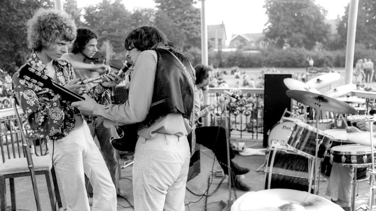 David Bowie (L) playing with other musicians at the Beckenham bandstand in 1969