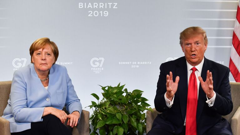German Chancellor Angela Merkel (L) and US President Donald Trump speak during a bilateral meeting in Biarritz, south-west France on August 26, 2019, on the third day of the annual G7 Summit. (Photo by Nicholas Kamm / AFP)        (Photo credit should read NICHOLAS KAMM/AFP/Getty Images)