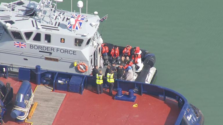 The migrants waiting to disembark