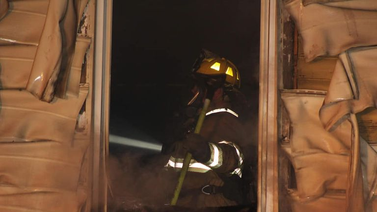 A firefighter working in the home in Erie. Pic: Scooter Blakely/Erie fire department