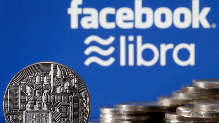 PARIS, FRANCE - JUNE 24: In this photo illustration, a visual representation of a digital cryptocurrency coin sits on display in front of Libra and Facebook logos on June 24, 2019 in Paris, France. Since the announcement of its creation a few days ago, the virtual currency of Facebook Libra fascinates as much as it worries. Thus, a few days after the announcement of the arrival of the social network in the sector, the Bank for International Settlements (BIS) considers that the incursion of major