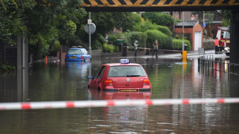 A car stranded in flood water in Crossley Road in Manchester this week