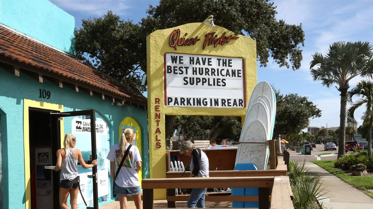 A surf shop advertises hurricane supplies as Hurricane Dorian approaches the coast in Cocoa Beach, Florida