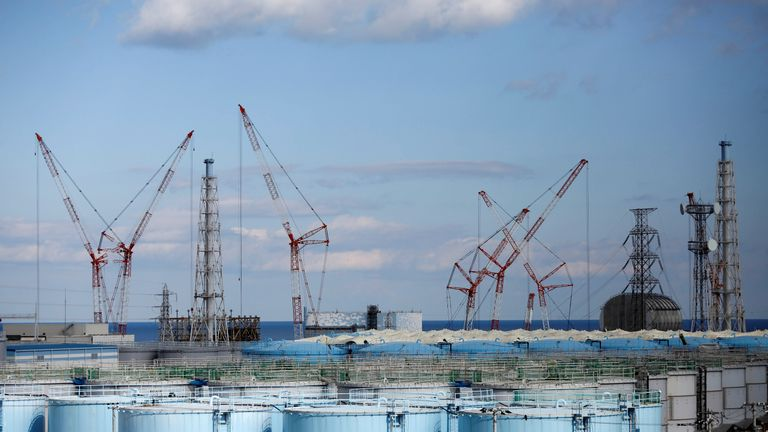 The reactor units No. 1 to 4 are seen over storage tanks for radioactive water at Tokyo Electric Power Co's (TEPCO) tsunami-crippled Fukushima Daiichi nuclear power plant