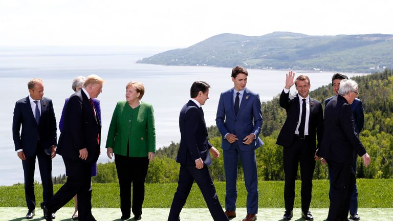 The G7 summit leaders, including European Council President Donald Tusk, Britain's Prime Minister Theresa May, Germany's Chancellor Angela Merkel, Canada's Prime Minister Justin Trudeau, U.S. President Donald Trump, France's President Emmanuel Macron, Japan's Prime Minister Shinzo Abe and European Commission President Jean-Claude Juncker after posing for a family photo with the leaders of the G-7 summit in the Charlevoix city of La Malbaie