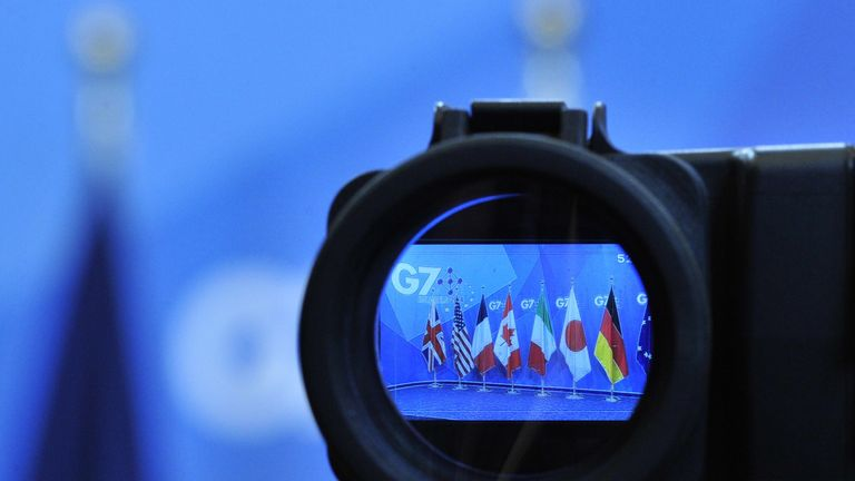Flags are seen in a camera screen at the G7 summit at the European Council headquarters on June 5, 2014 in Brussels.  AFP PHOTO / GEORGES GOBET        (Photo credit should read GEORGES GOBET/AFP/Getty Images)
