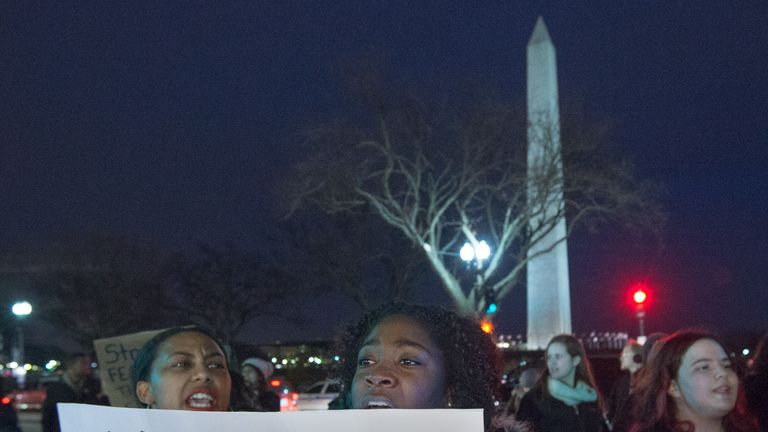 Protesters march on streets around the White House perimeter in Washington, DC during the annual White House Christmas Tree lighting ceremony, December 4, 2014, against the chokehold death of an unarmed black father-of-six by a white police officer