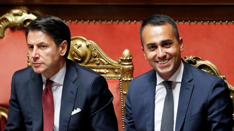 Italian Deputy Prime Minister and Labour Minister Luigi di Maio and Italian Prime Minister Giuseppe Conte react during a session of the upper house of parliament