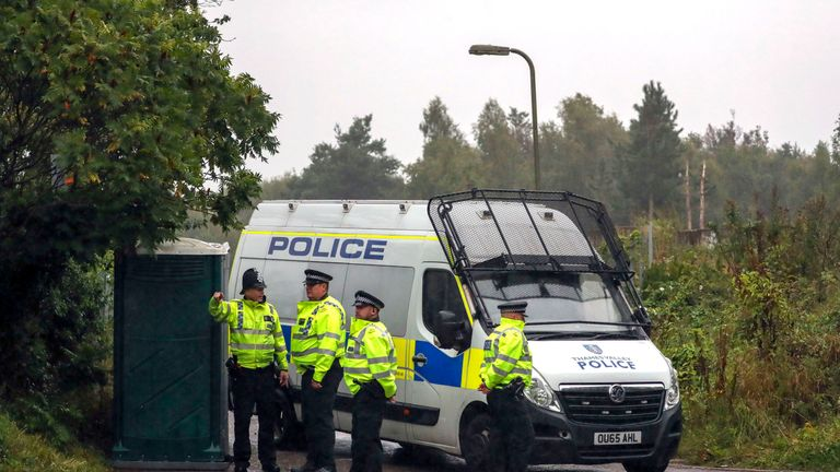 Police at a caravan site near Burghfield Common after the death of PC Harper