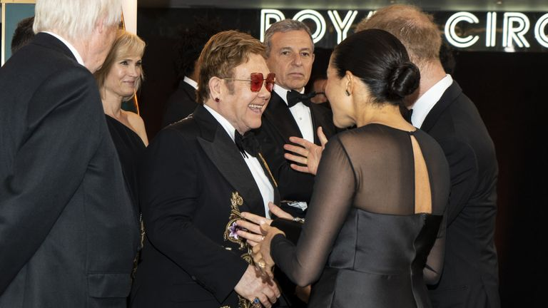 "Prince Harry, Duke of Sussex and Meghan, Duchess of Sussex greet British singer-songwriter Elton John and David Furnish at the European Premiere of Disney's ""The Lion King"" at Odeon Luxe Leicester Square on July 14, 2019 in London, England"
