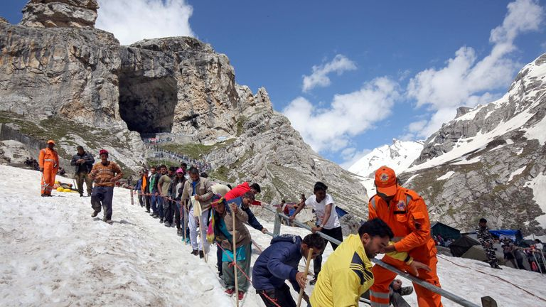 Hindu pilgrims leave the holy cave of Lord Shiva after worshipping in Amaranth, southeast of Srinagar. File pic