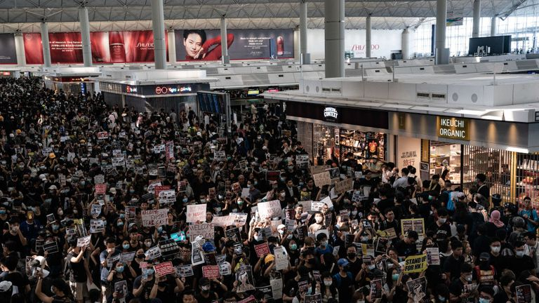 The departure hall is crammed with protesters