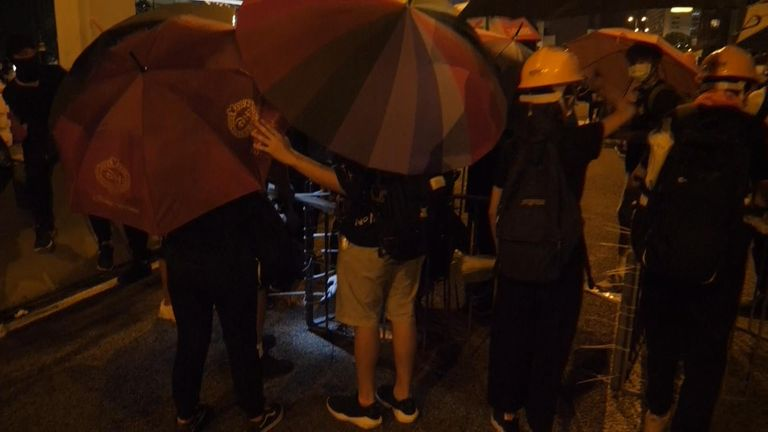 Protesters were 'well organised' and used umbrellas to protect their identities, Stuart Ramsay said