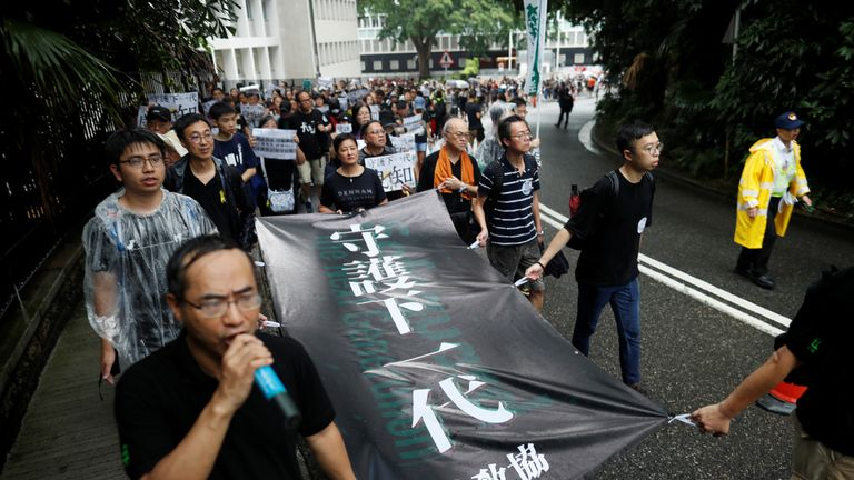 Hong Kong teachers march against police brutality