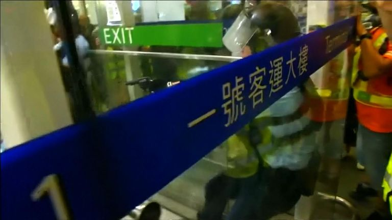 Police and protesters clashed at Hong Kong airport, where a huge pro-democracy demonstration is taking place.