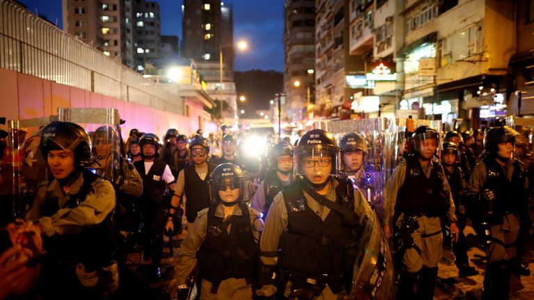Hong Kong police rush protesters after brief stand-off