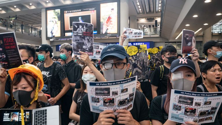 The shooting of a woman in the eye on Hong Kong's streets has swelled numbers at the airport