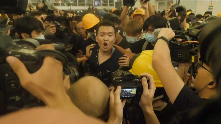 Hong Kong protesters detain a man