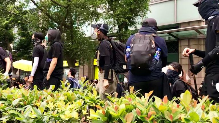 A police station is surrounded by protesters