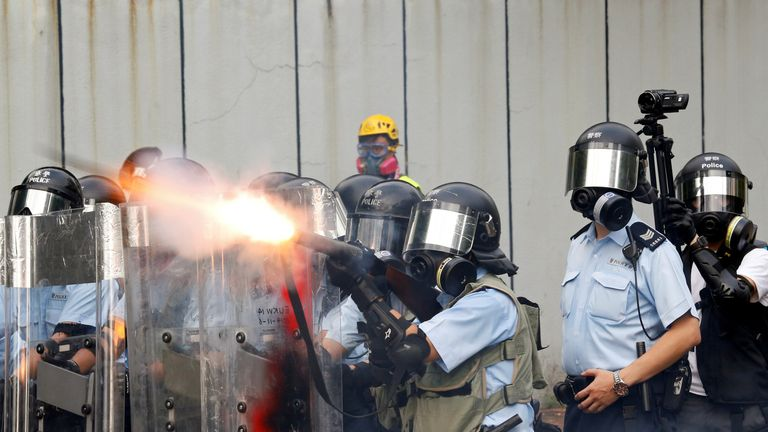 Police officers fire tear gas as anti-extradition bill protesters demonstrate in Sham Shui Po neighbourhood in Hong Kong, China, August 11, 2019.