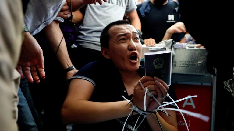 Fu Guohao, reporter of Chinese media Global Times website, is tied by protesters