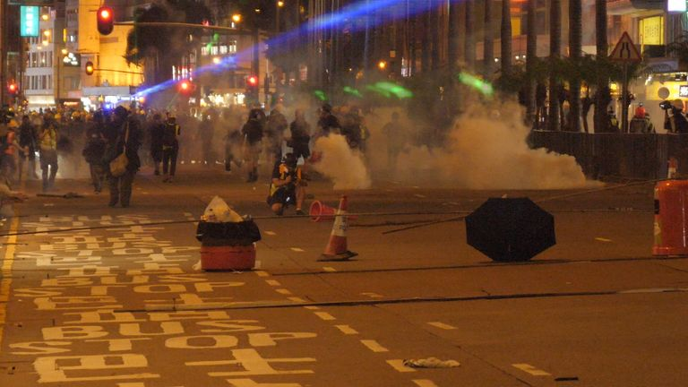 Police are using tear gas to push protesters back