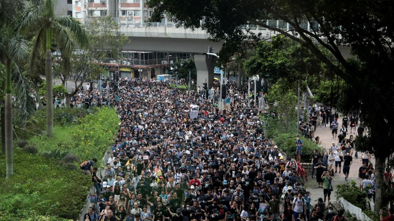 Thousands of pro-democracy protesters, many wearing black, joined the march