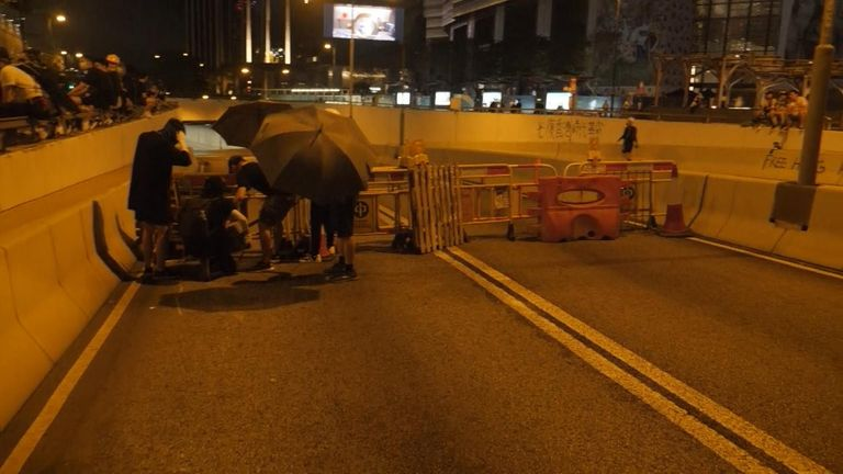 Protesters blocked the entrance to the main subway tunnel linking Kowloon and Hong Kong island