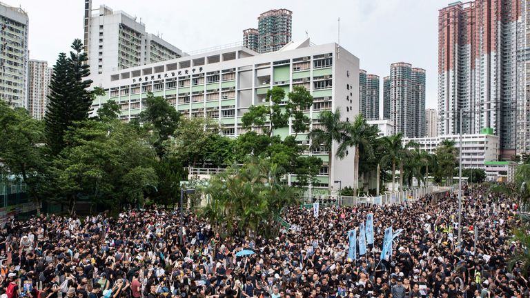 Thousands of people defied police to march in Tseung Kwan O district on Sunday in the latest pro-democracy protest