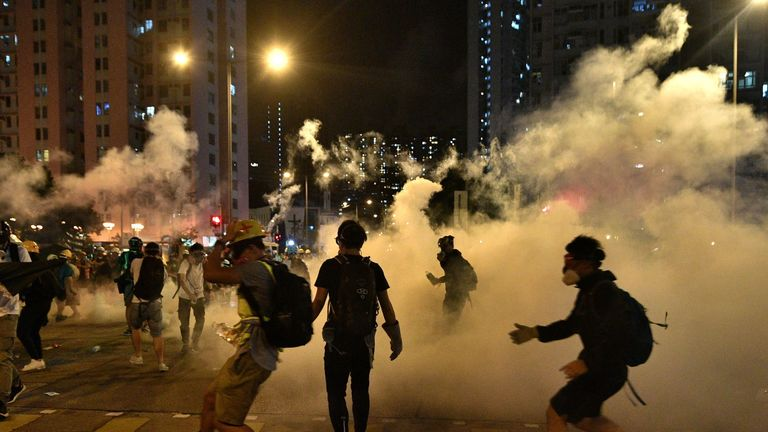Police fire tear gas at protesters outside a police station in the Wong Tai Sin district on Saturday