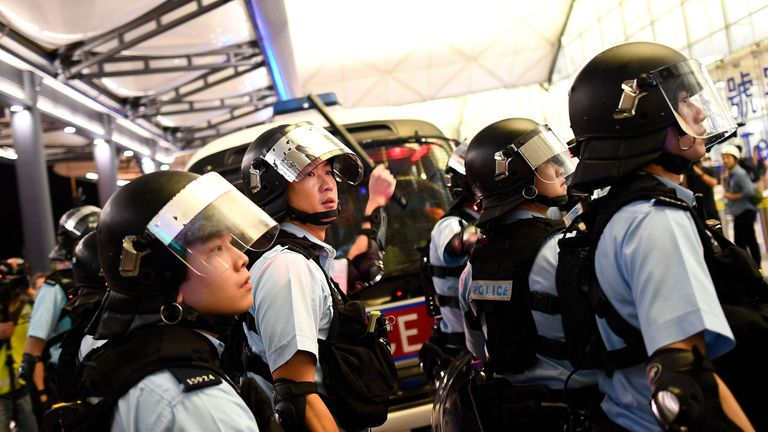 Riot officers have clashed with protesters at Hong Kong airport after flights were disrupted for a second day
