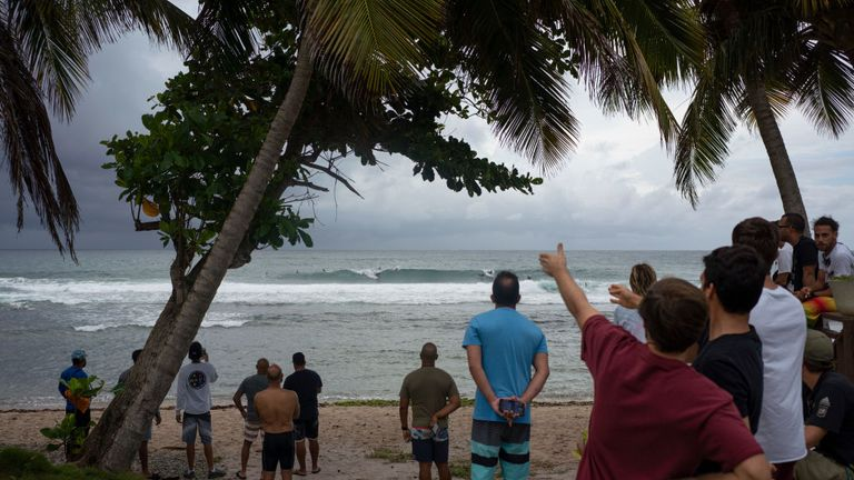 People await the arrival of what was then Tropical Storm Dorian in Puerto Rico on Wednesday
