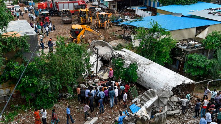 A search operation is under way after an overhead water tank collapsed due to heavy rains in Ahmedabad