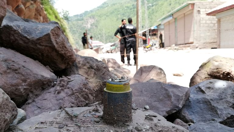 A cluster bomb shell is seen along a roadside in Noseri, near the line of control in Kashmir