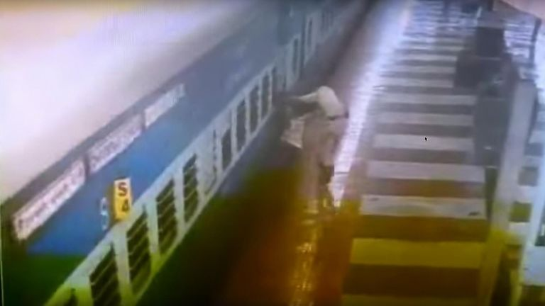 Man trapped between train and platform