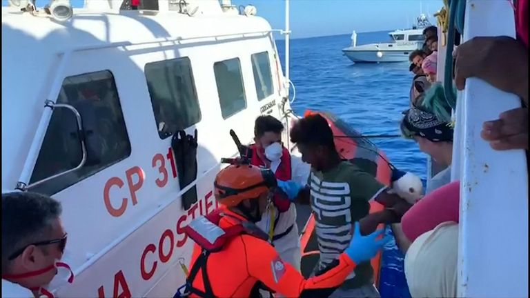 Migrant children finally allowed off stranded boat