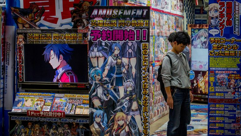 TOKYO, JAPAN - MAY 20: A man looks at DVD's at a shop in Akihabara, Electric Town on May 20, 2014 in Tokyo, Japan. Akihabara gained the nickname Akihabara Electric Town after World War II as it became a mecca for household electronic goods. Today Akihabara has become a major Tokyo tourist attraction and Otaku cultural center. Otaku is a Japanese term for people with obsessive interests and is often associated with the anime and manga movements. The district is cluttered with stores specializing