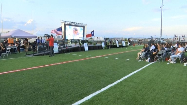 The vigil took place on the Horizon High School's football field