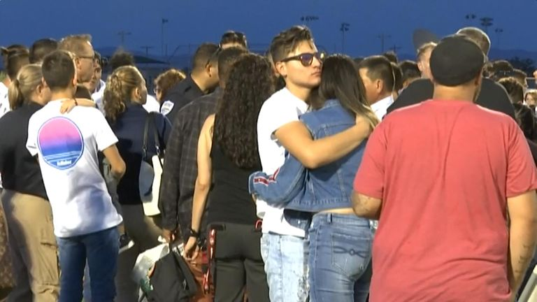 People embraced after speeches were made in tribute to Mr Rodriguez