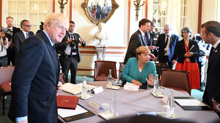 Prime Minister Boris Johnson (left) at the EU meeting during the G7 summit in Biarritz, France