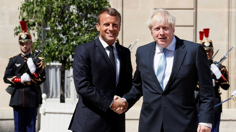 RTS2NE2X22 Aug. 2019Paris, FranceFrench President Emmanuel Macron welcomes British Prime Minister Boris Johnson before a meeting on Brexit at the Elysee Palace in Paris, France, August 22, 2019. REUTERS/Gonzalo Fuentes
