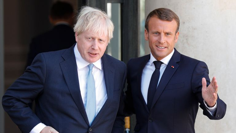 French President Emmanuel Macron (R) welcomes Britain's Prime Minister Boris Johnson (L) prior to their meeting at The Elysee Palace in Paris on August 22, 2019.