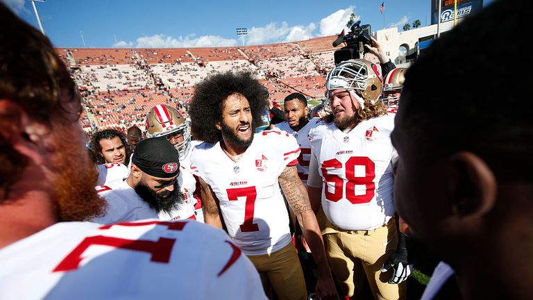 Colin Kaepernick #7 of the San Francisco 49ers fires the team up on the field prior to the game against the Los Angeles Rams at the Los Angeles Coliseum on December 24, 2016