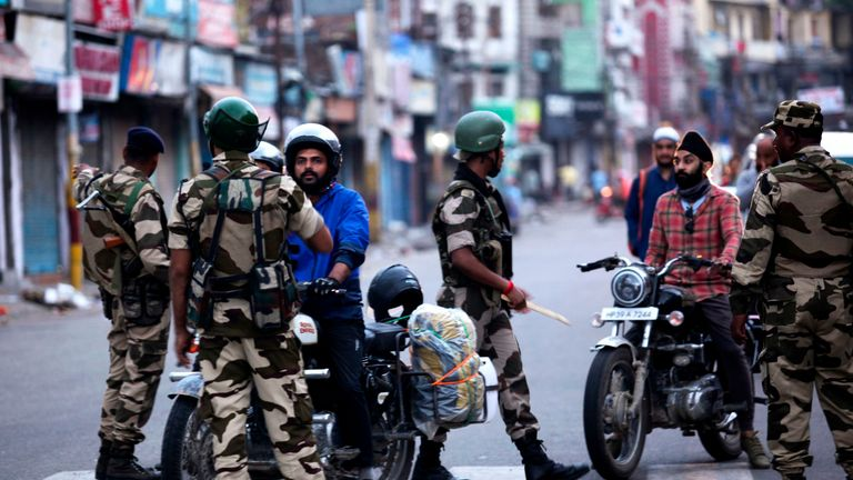 Motorists are questioned in Jammu after authorities placed large parts of the disputed region under lockdown