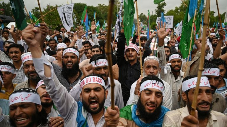 Supporters of the Pakistani political party Jammat-e-Islami shout slogans in the country's capital