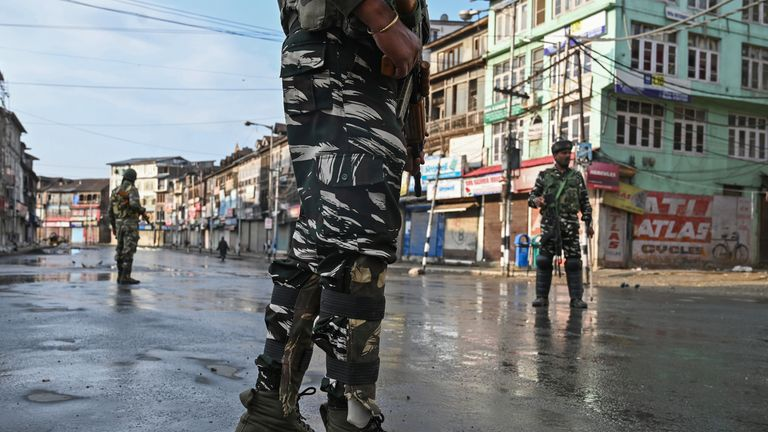 Soldiers patrol the streets of Srinagar, the largest city in Indian-administered Kashmir