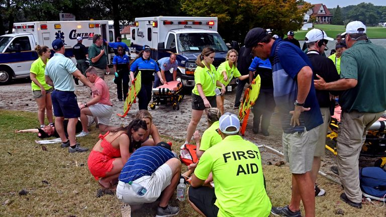 Fans are assisted by medical personnel after a lightning strike during the third round of the Tour Championship at East Lake Golf Club. Pic: Adam Hagy-USA TODAY Sports