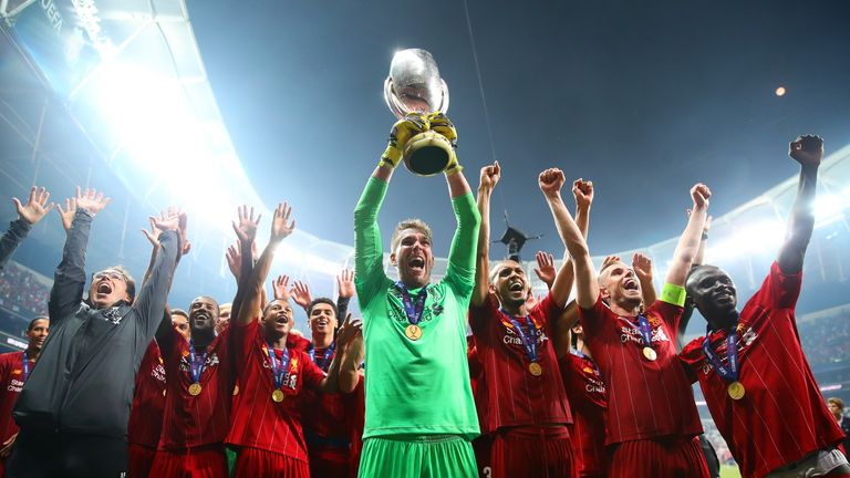 Adrian lifts the UEFA Super Cup after his penalty save won the trophy for Liverpool