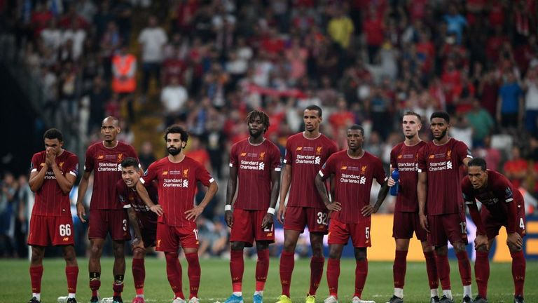 Liverpool's players look on during a penalty shootout before winning the UEFA Super Cup 2019 football match between FC Liverpool and FC Chelsea at Besiktas Park Stadium in Istanbul on August 14, 2019. (Photo by Bulent Kilic / AFP) (Photo credit should read BULENT KILIC/AFP/Getty Images)